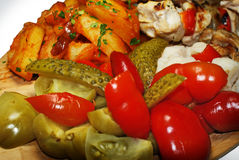 Pickles mix. Pickles and barbecue mix with fried potatoes Stock Images