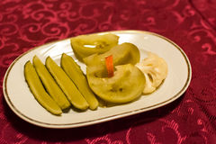 Pickles on plate Stock Photos