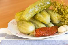 Pickles on a plate. Pickles and spices on a plate Royalty Free Stock Photos