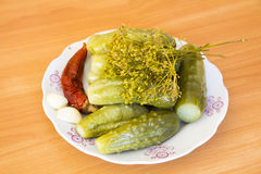 Pickles on a plate. Pickles and spices on a plate Stock Photos