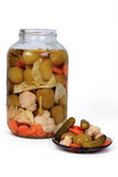 Pickles preserves. Winter vegetables in a jar and on a plate Stock Images
