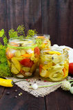 Pickles: vegetable assortment zucchini, pepper, carrots, tomato, green peas Stock Images