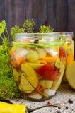 Pickles: vegetable assortment zucchini, pepper, carrots, tomato, green peas Stock Photos