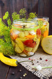 Pickles: vegetable assortment zucchini, pepper, carrots, tomato, green peas Royalty Free Stock Photos
