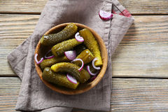 Pickles in wooden bowl. Food Stock Images