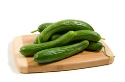Pickling cucumber on a board Royalty Free Stock Photos
