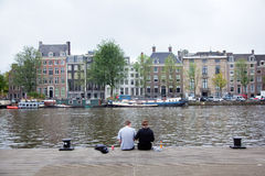 Picknick on the embankment of river amstel Stock Photography