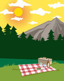 Picknick. Picnic in a beautiful rural mountain landscape with wine glasses and wicker basket Stock Image