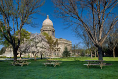 Picknick tables on the grass at the Capital Royalty Free Stock Photos