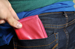 Pickpocket. A pickpocket is trying to steal a wallet Royalty Free Stock Photos
