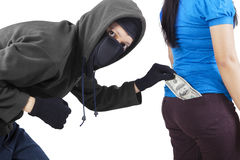Pickpocket in action to take money Royalty Free Stock Photography