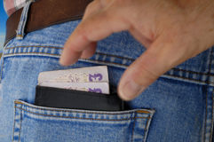 Pickpocket in action - Wallet. Stock Image