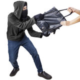 Pickpocket grabbing handbag from a woman Stock Images