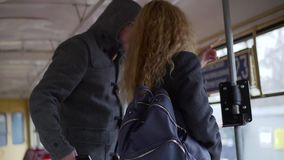 Pickpocket stealing phone from a woman`s handbag in tram or bus.  stock video footage