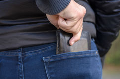 Pickpocket stealing a protruding purse Royalty Free Stock Images