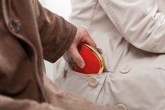 Pickpocket stealing a wallet. From a lady sitting next to him Royalty Free Stock Photos