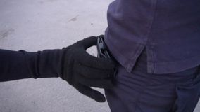 A pickpocket steals the wallet from a mans back pocket stock video footage