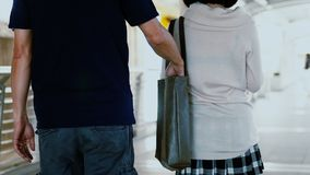 pickpocket thief took wallet of pretty girl while walking Stock Photo