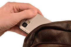 Pickpocketing of a mobile phone Royalty Free Stock Photography