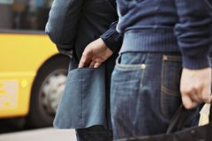 Pickpocketing on the street during daytime stock photography