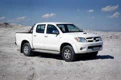 Pickup. Truck on white sand stock images