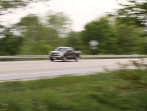 Pickup blur on highway Royalty Free Stock Photo