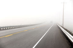 Pickup drives into dense fog Royalty Free Stock Images