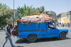 Pickup full of carpet. Pickup carrying carpet and a four wheel cart near tehran grand bazaar Stock Images