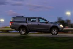 Pickup moves at high speed in the evening. On the highway Stock Image