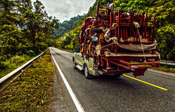 Pickup overloaded with house utensils. Royalty Free Stock Photography
