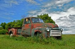 Pickup with Patina. An old vintage pickup parked in a field is a beautiful display of patina Stock Photography