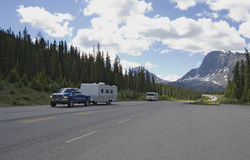 Pickup with trailer having a good trip in the rockies Royalty Free Stock Photography