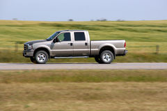 Pickup truck. Pick up truck in motion. Speed blur. Road abstract Royalty Free Stock Images