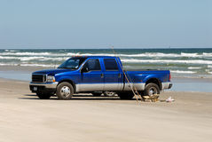 Pickup truck on the beach Stock Images