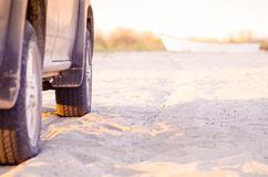 Pickup truck on the beach sand. With boat in background Stock Photography