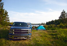 A pickup truck on a campsite Stock Image