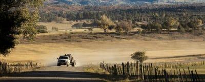 Pickup truck drives County Road 24 near Ridgway Colorado looking. September 28,, 2018, USA - Pickup truck drives County Road 24 near Ridgway Colorado looking stock photography