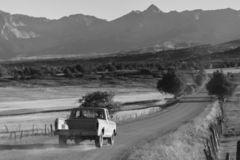 Pickup truck drives County Road 24 near Ridgway Colorado looking. September 28,, 2018, USA - Pickup truck drives County Road 24 near Ridgway Colorado looking royalty free stock image