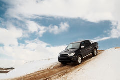 Pickup truck driving down the hill Royalty Free Stock Photos