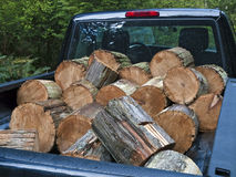 Pickup truck filled with firewood. Pickup truck loaded with a bucked up old telephone pole Royalty Free Stock Image