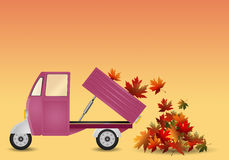 Pickup truck with leaves in autumn Stock Photos