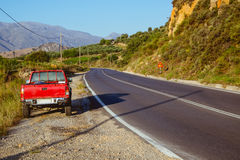 Pickup truck on mountain road Royalty Free Stock Photo