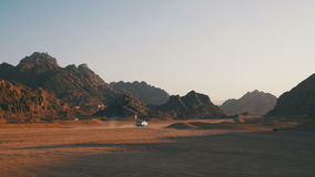 Pickup truck moves Through the Desert in Egypt, on Sand and Mountains Background stock video