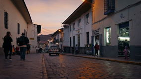 Pickup Truck Passes Through South American Town At Sunset. Pickup truck drives past on old cobbled road at sunset in Cusco, Peru stock video