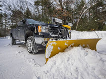Pickup truck plowing snow Royalty Free Stock Photo