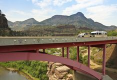 A Pickup Pulling a Travel Trailer Across the Salt River Canyon B Stock Photo