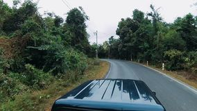 A pickup truck ride. Pickup truck ride through the jungle road of thailand stock video