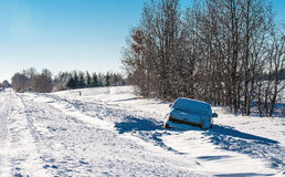 Pickup Truck Stuck in Snow. While driving in a blizzard, this 4-wheel drive truck ended up in the ditch Royalty Free Stock Photo