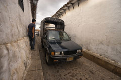Pickup truck taxi in Giron COlombia. July 23, 2017 Giron, Santander: a small pickup truck taxi driving through a narrow cobblestone street in the colonial town Stock Photos
