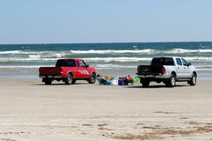 Pickup trucks on the beach Royalty Free Stock Photo